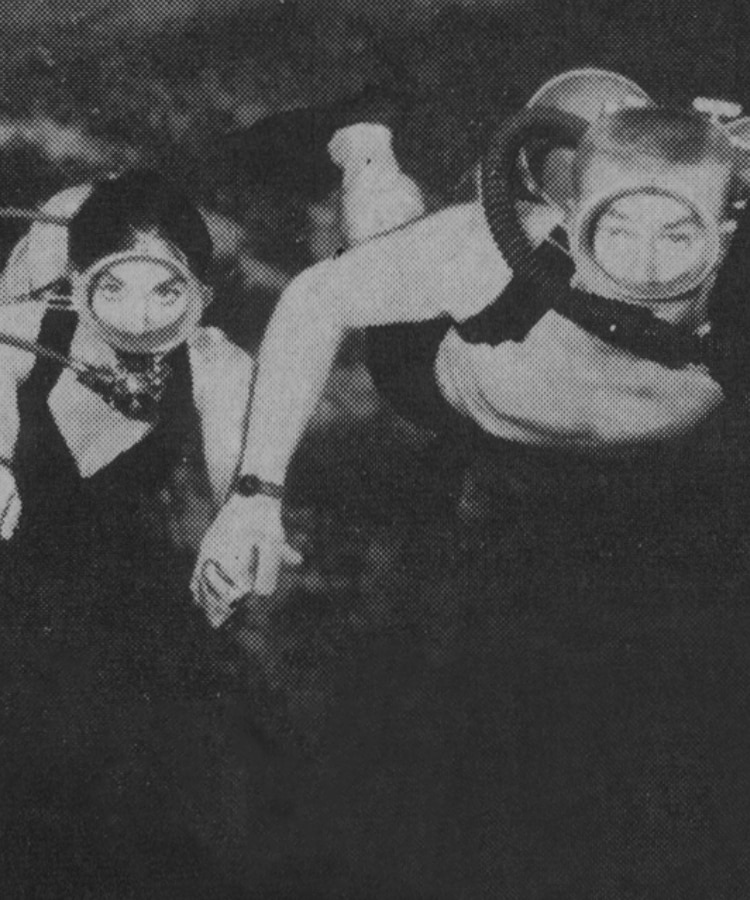 Black and white vintage photo of two people snorkeling.