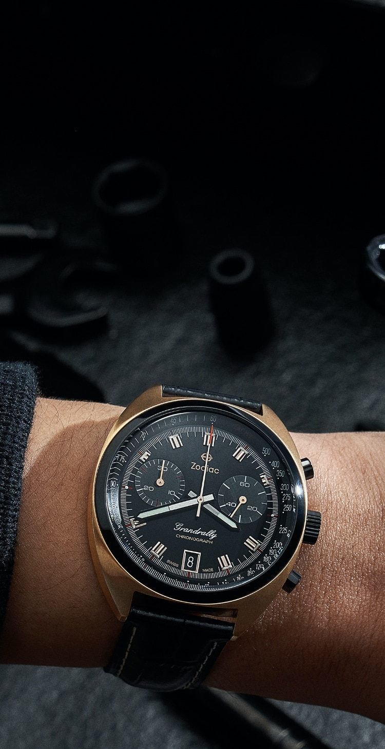 A black and rose gold plated Grandrally on a man's wrist.