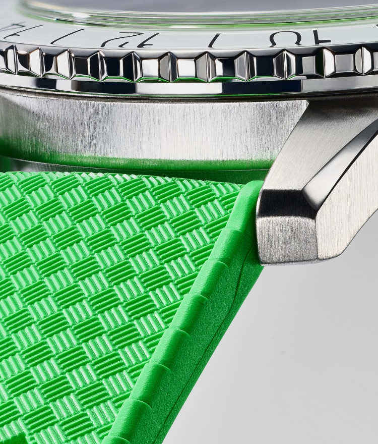 A close up of a green Tropic rubber strap.
