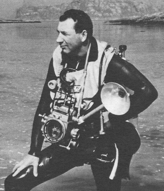 A vintage photo of a diver with his camera